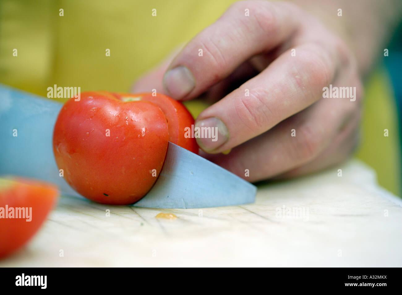 Cutting tomato Stock Photo
