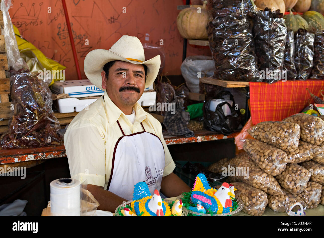 MEXICO San Miguel de Allende Mexican man wearing cowboy hat sell dried  chiles nuts and sweets for Day of the Dead 9bdd67343b6