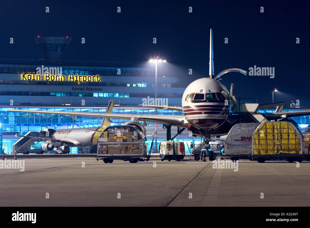 a dhl cargo plane at the cologne bonn airport at night germany stock photo 10652399 alamy. Black Bedroom Furniture Sets. Home Design Ideas