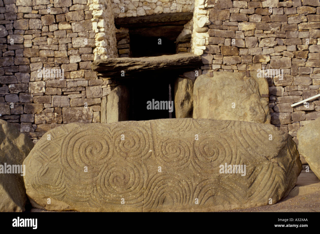 The triple spiral, found only at Newgrange, Ireland occurs both on the entrance stone and inside the chamber. Stock Photo