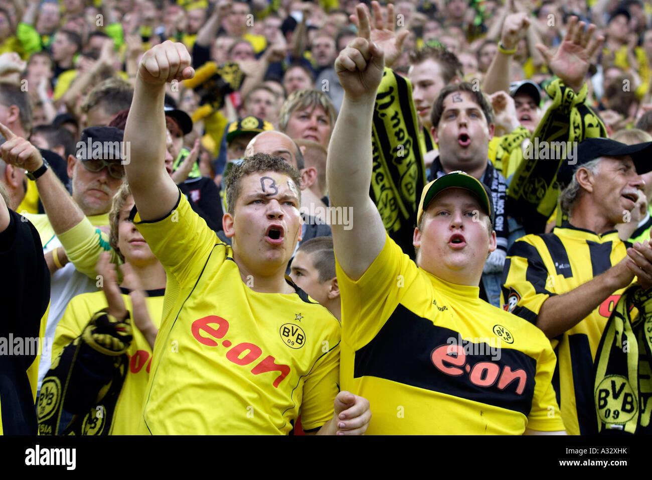 Fans of Borussia Dortmund football club at a stadium, Germany - Stock Image