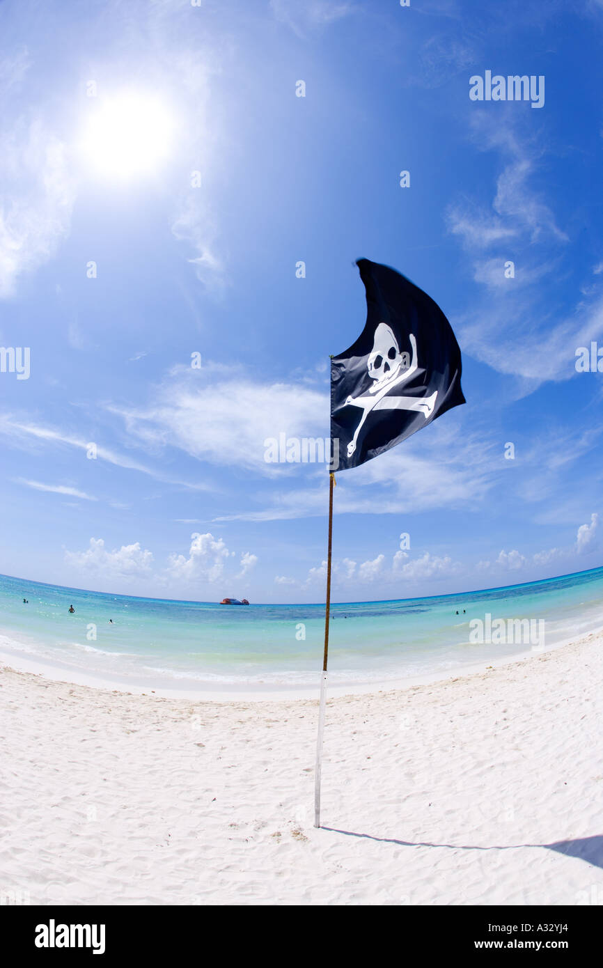 Pirate flag on beach in Playa del Carmen, Mexico, Caribbean. - Stock Image