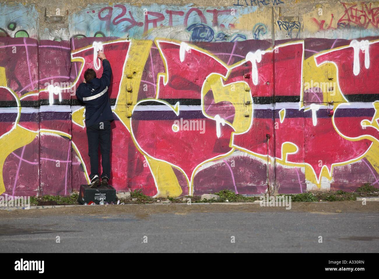 young Graffitti artist - Stock Image