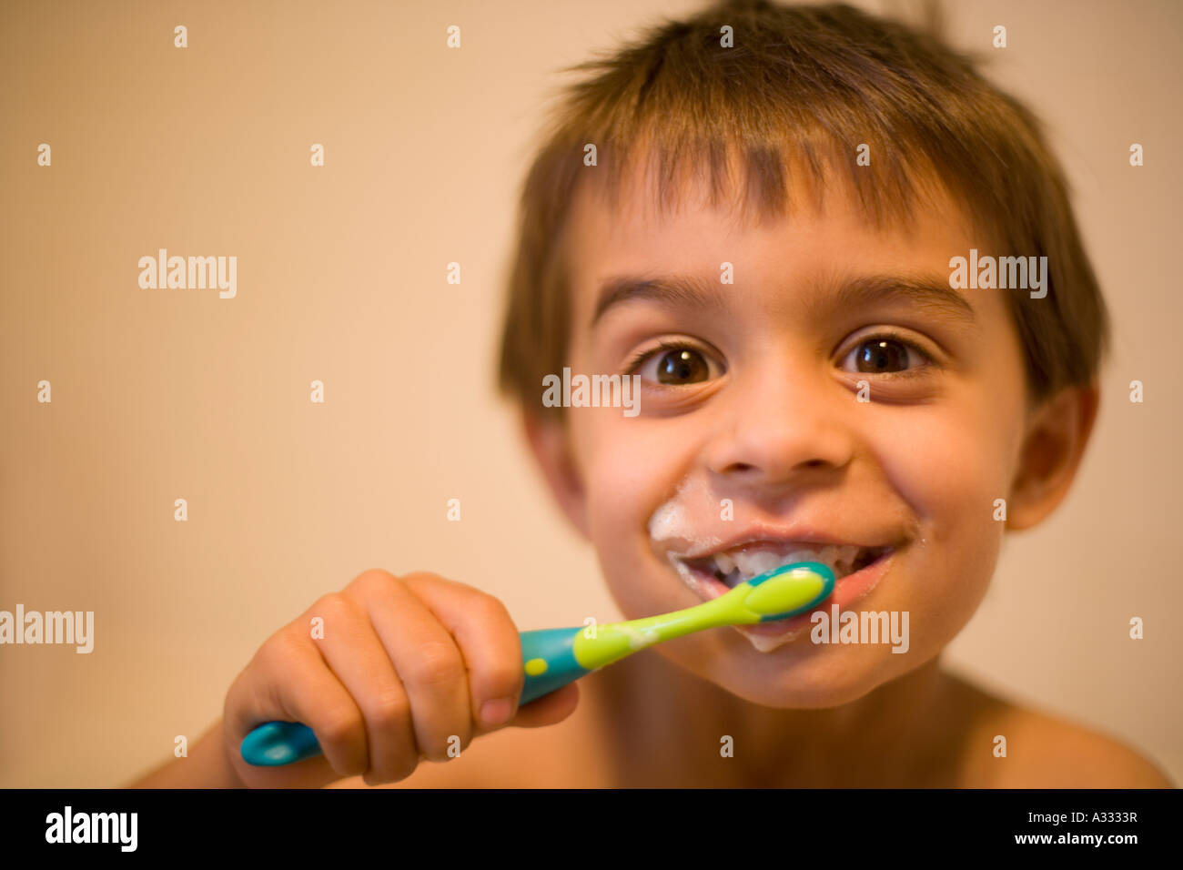 Little boy brushes his teeth. PR for house and home. - Stock Image