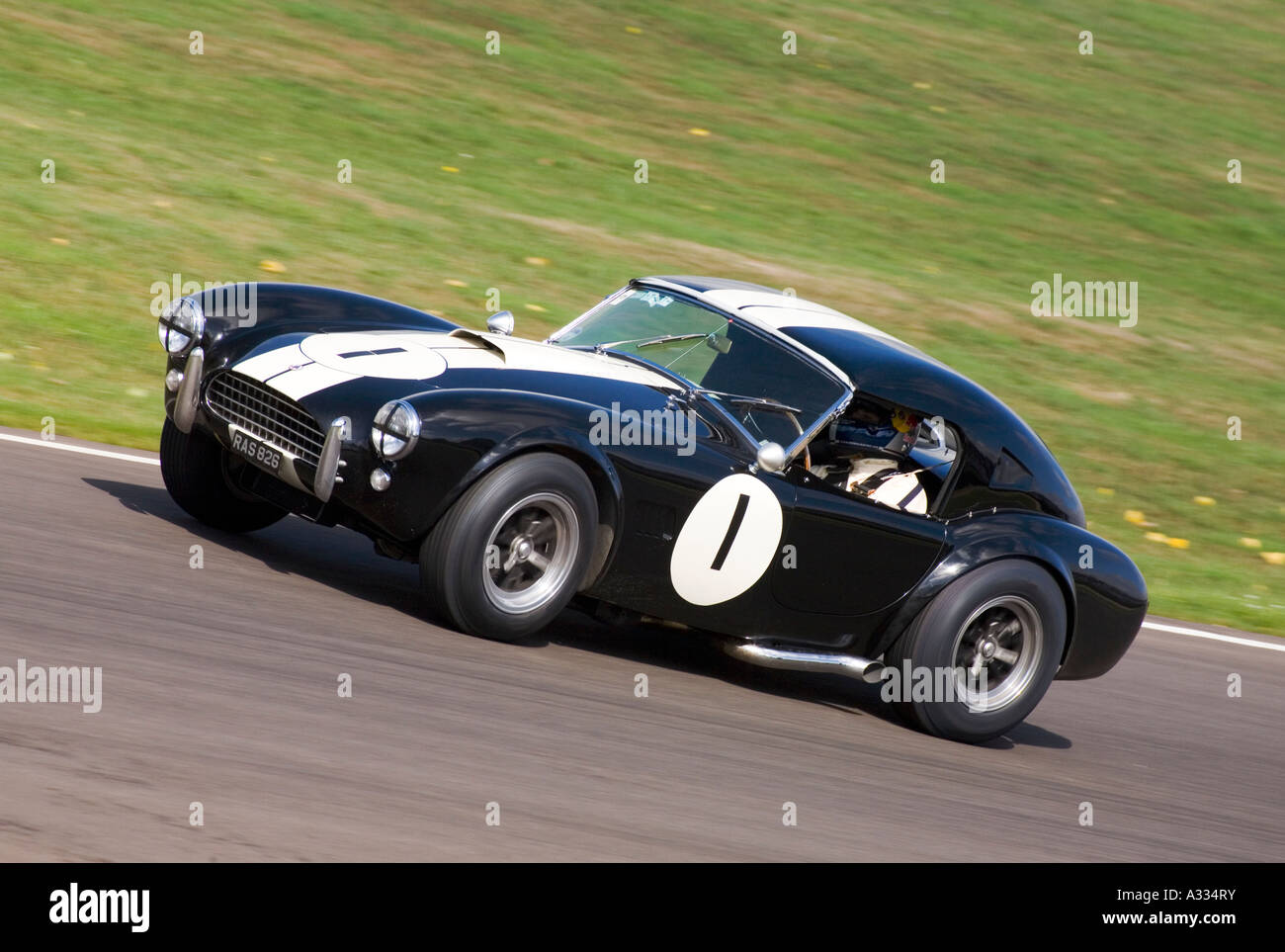 1964 AC Cobra during the Royal Automobile Club TT Celebration race at Goodwood, Sussex. - Stock Image