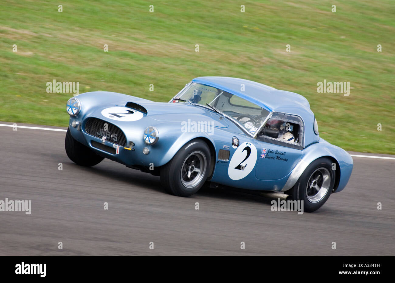 1962 AC Cobra during the Royal Automobile Club TT Celebration race at Goodwood Revial, Sussex. - Stock Image