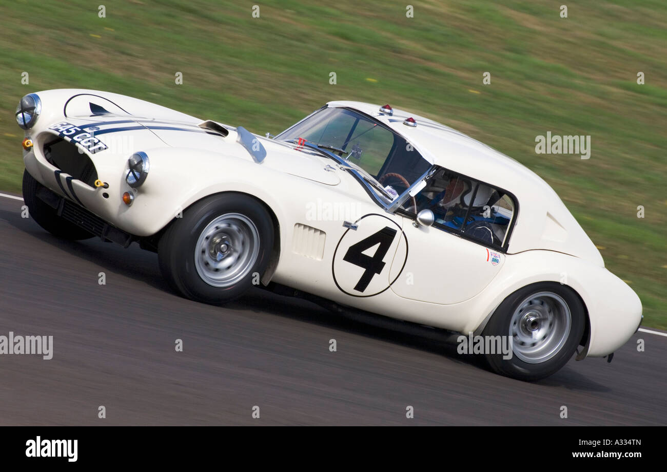 1963 AC Cobra Le Mans Coupe during the Royal Automobile Club TT Celebration race at Goodwood. - Stock Image