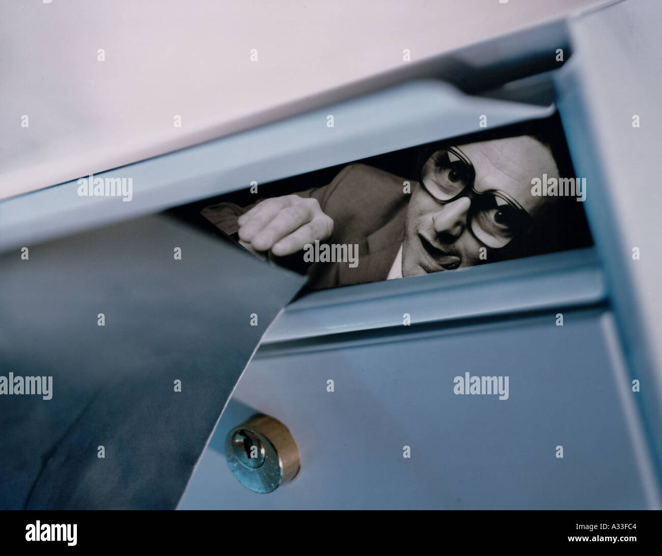 Spy behind the Letterbox Stock Photo