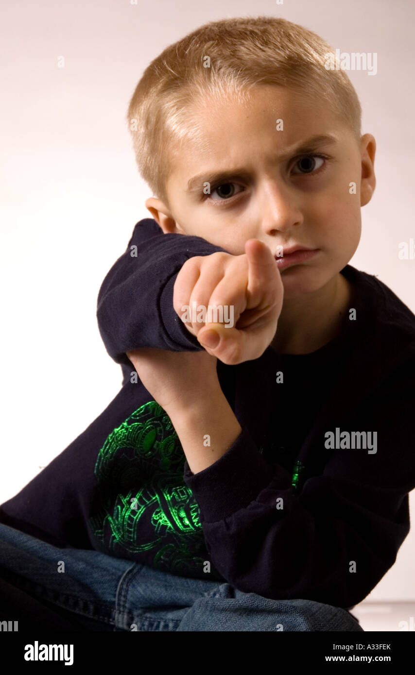 Young boy poses for camera in an informal portrait setting - Stock Image