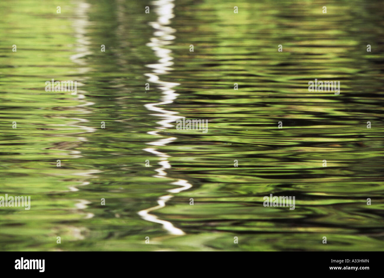 Reflections on Rippled water surface at Wangi Falls plunge pool Litchfield National Park Northern Territory Australia - Stock Image