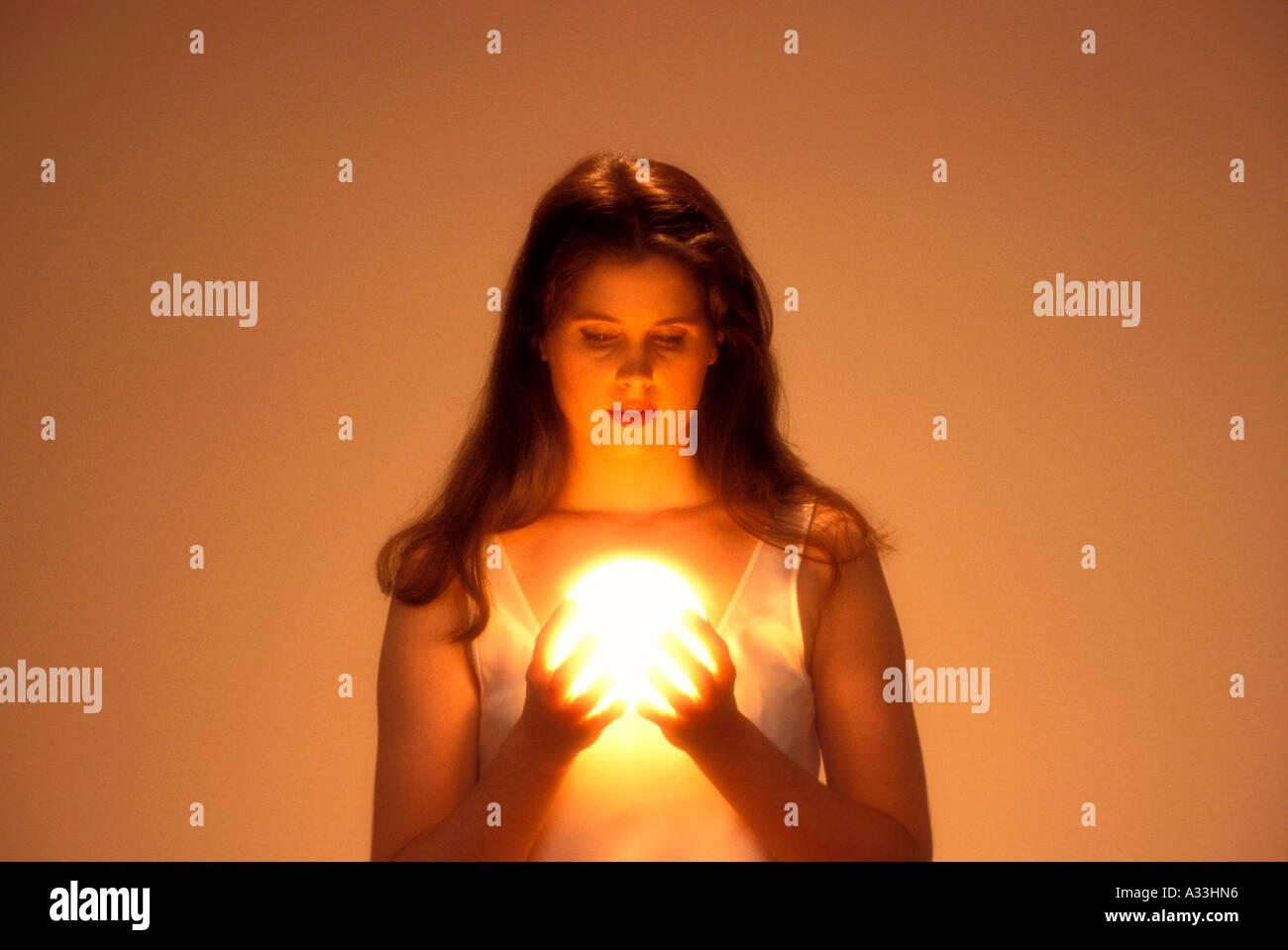 Woman gazes into crystal ball 6EF - Stock Image