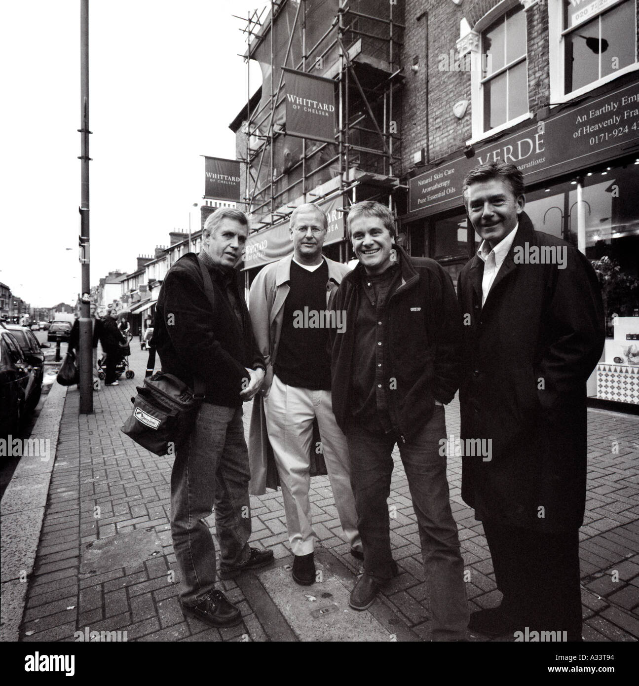 Four middle aged blokes on a London street - Stock Image
