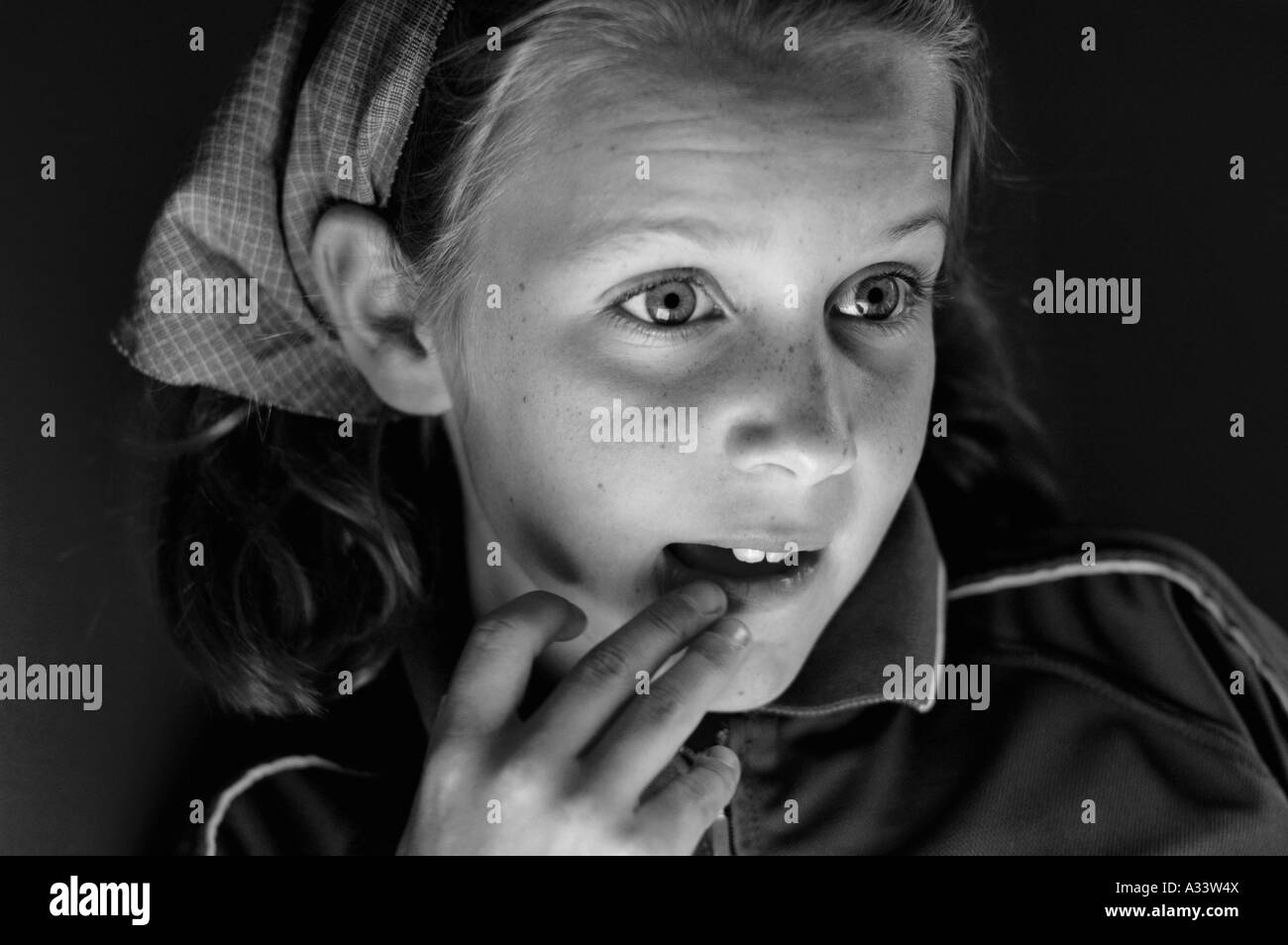portrait of young girl gripped by a  television programme - Stock Image