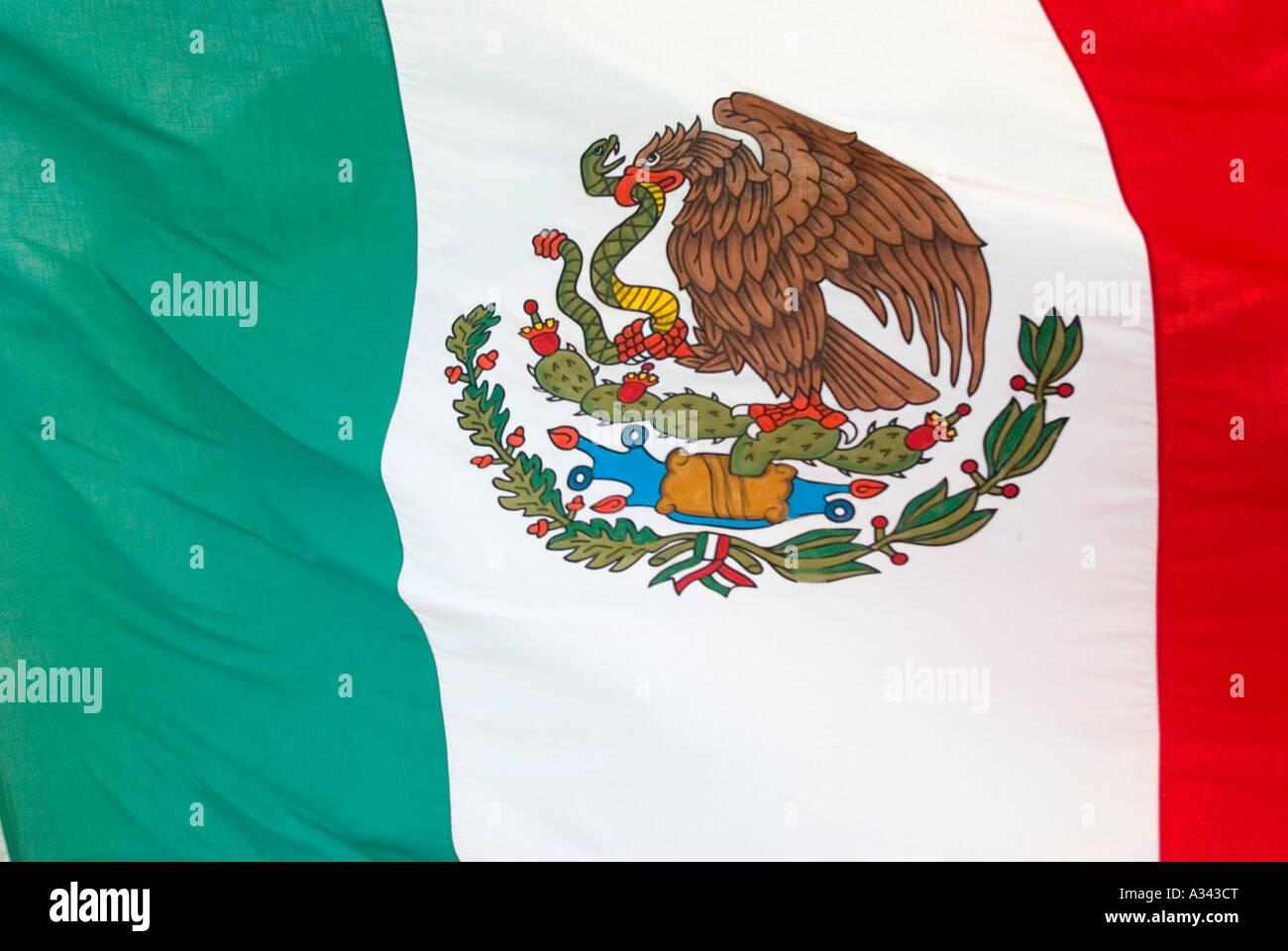 Mexican flag flying in Cabo San Lucas, Baja California, Mexico. - Stock Image