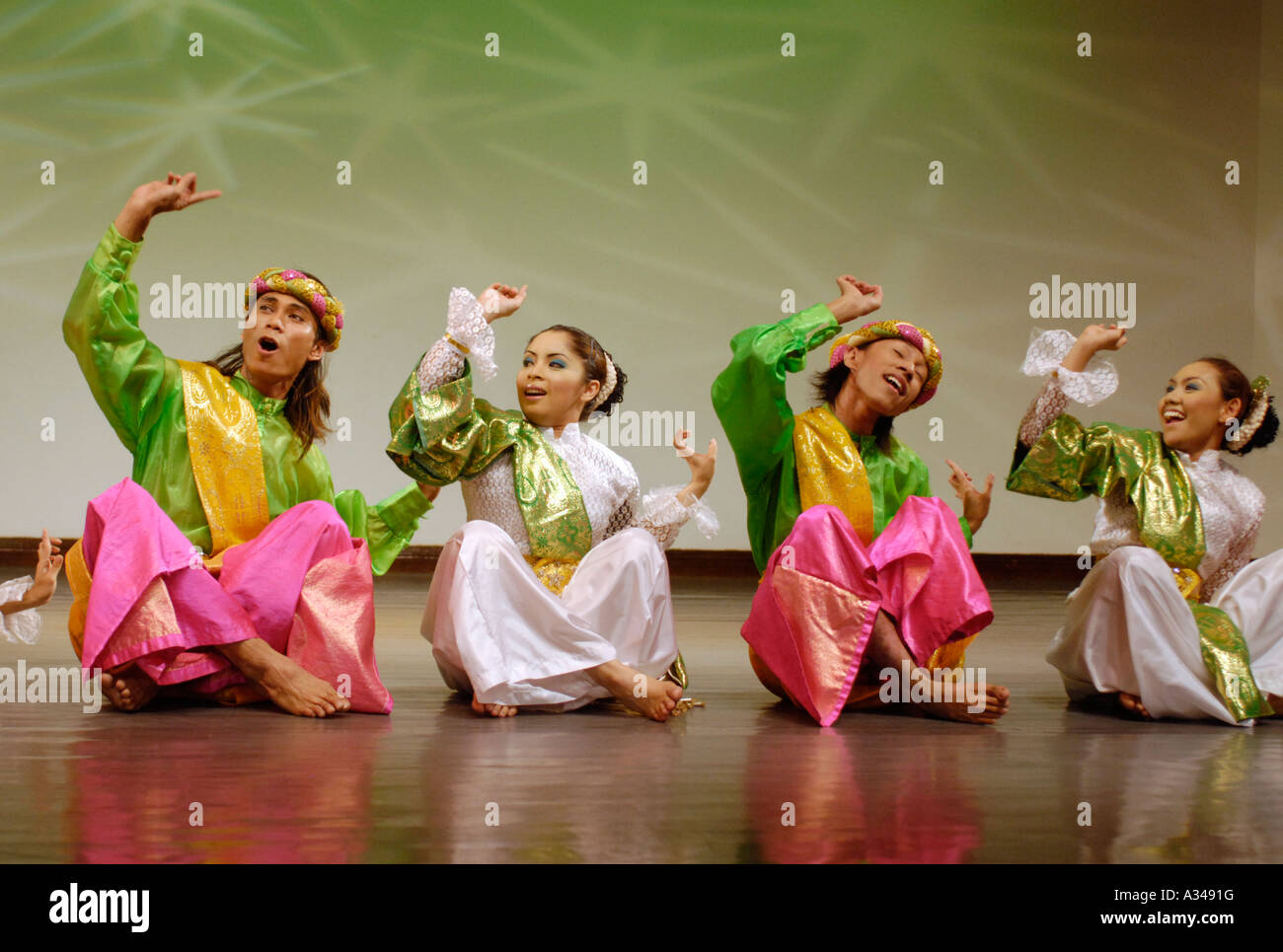Dancers Performing A Creative Dance That Originated With Malay