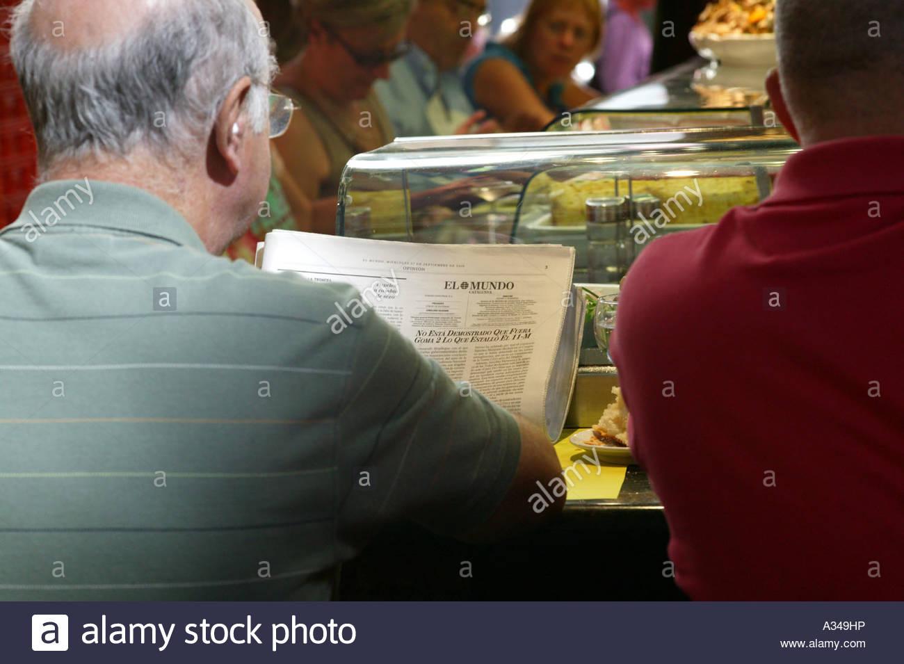 Lunch time at Barcelona's food market La Boqueria off La Rambla central Barcelona Spain - Stock Image