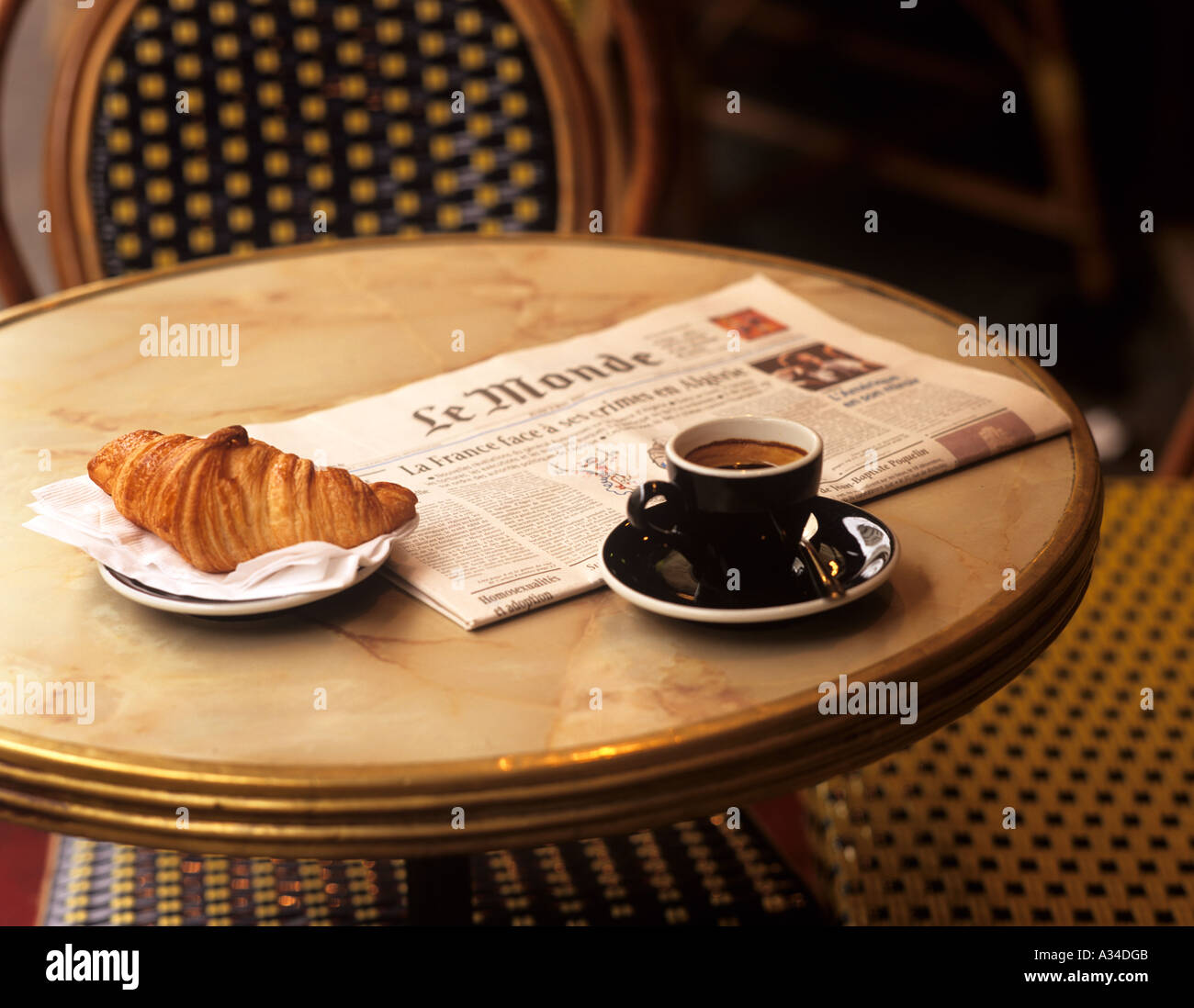 Coffee, croissant and newpaper in cafe , Paris, France . Stock Photo