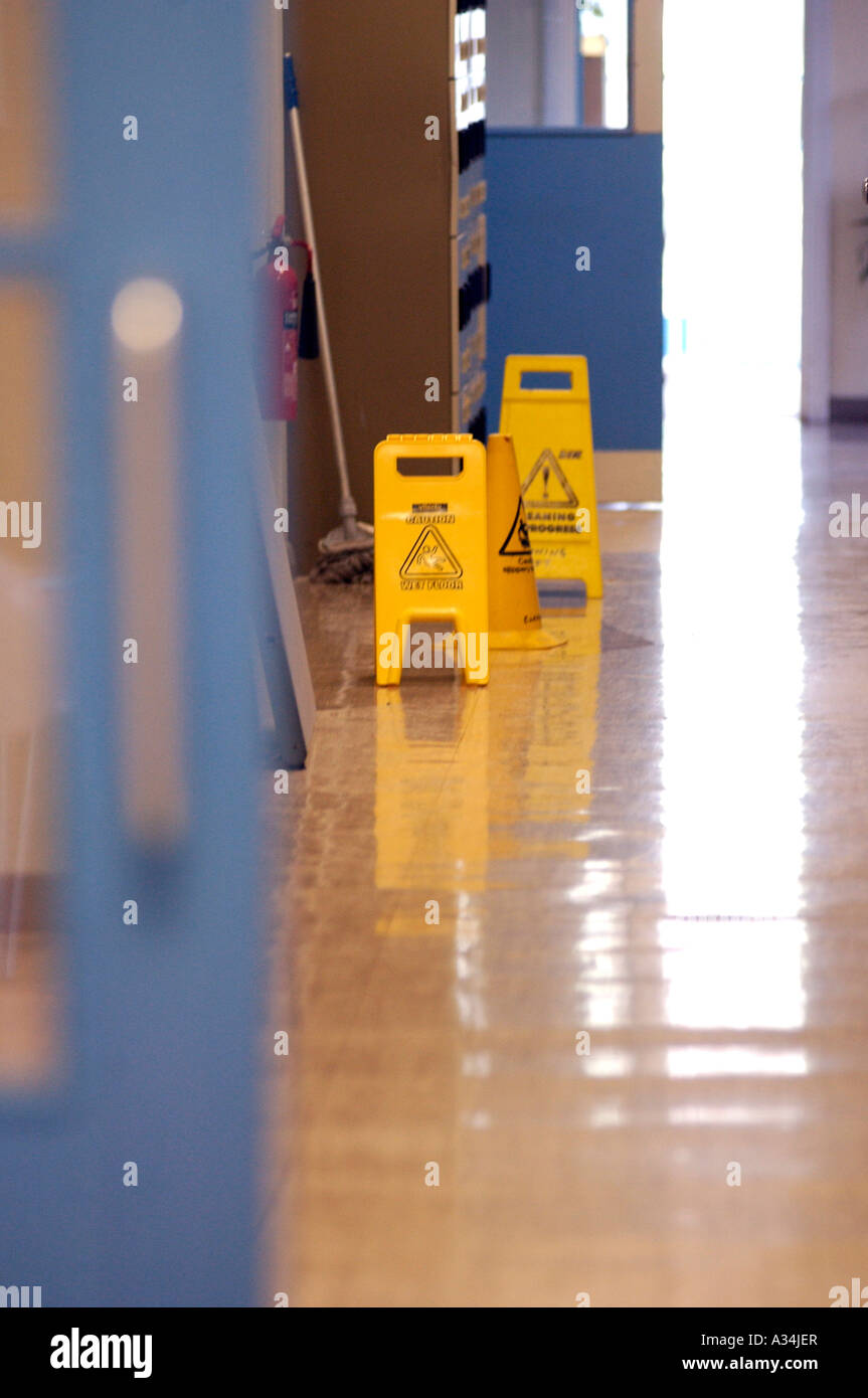 Royalty free photograph of UK hospital health and safety sign on an unhygienic ward corridor. - Stock Image