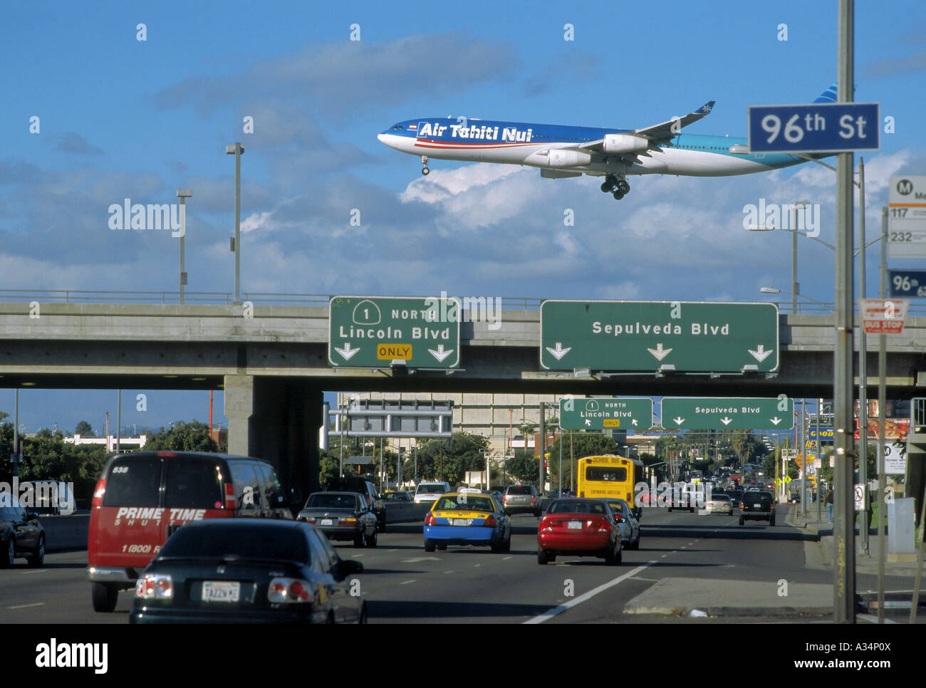 An Airbus 340-600 series widebody jet operated by Air Tahiti Nui crosses the Sepulveda Boulevard seconds before - Stock Image