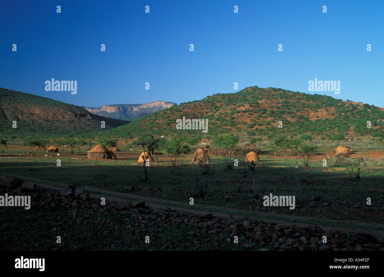 Huts and Kraal of Himba Ovahimba tribe nomadic people im Kaokoveld Namibia Africa - Stock Image