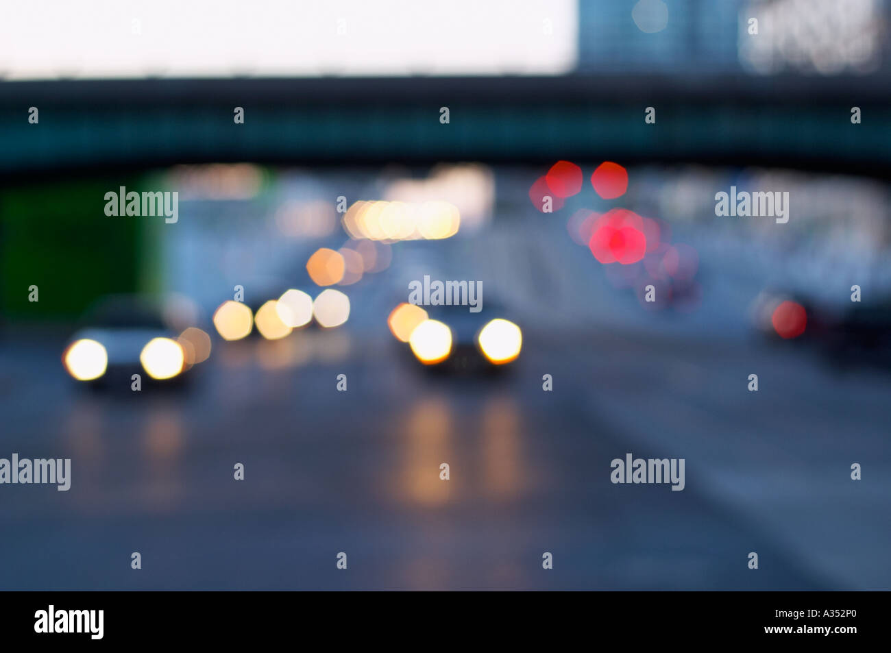 Blurred image of city highway traffic at dusk. Stock Photo