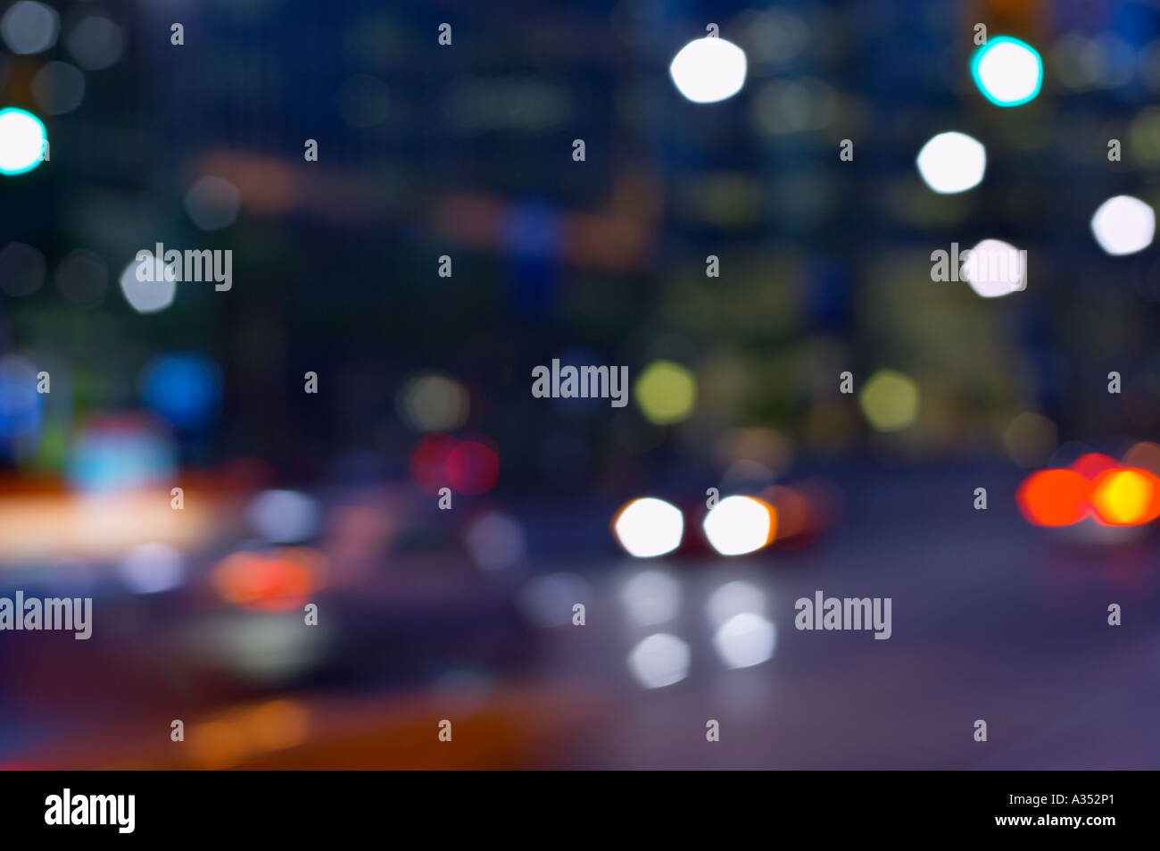 Blurred image of city traffic at dusk. Stock Photo