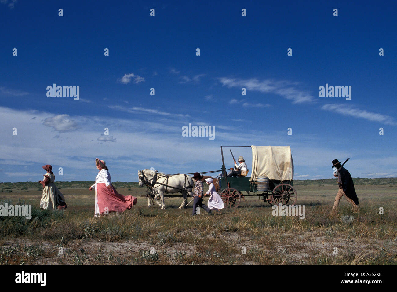 Pioneer family crosses prairie at the Little Bighorn Custer battle re enactment Crow Agency lands near Hardin Montana Stock Photo