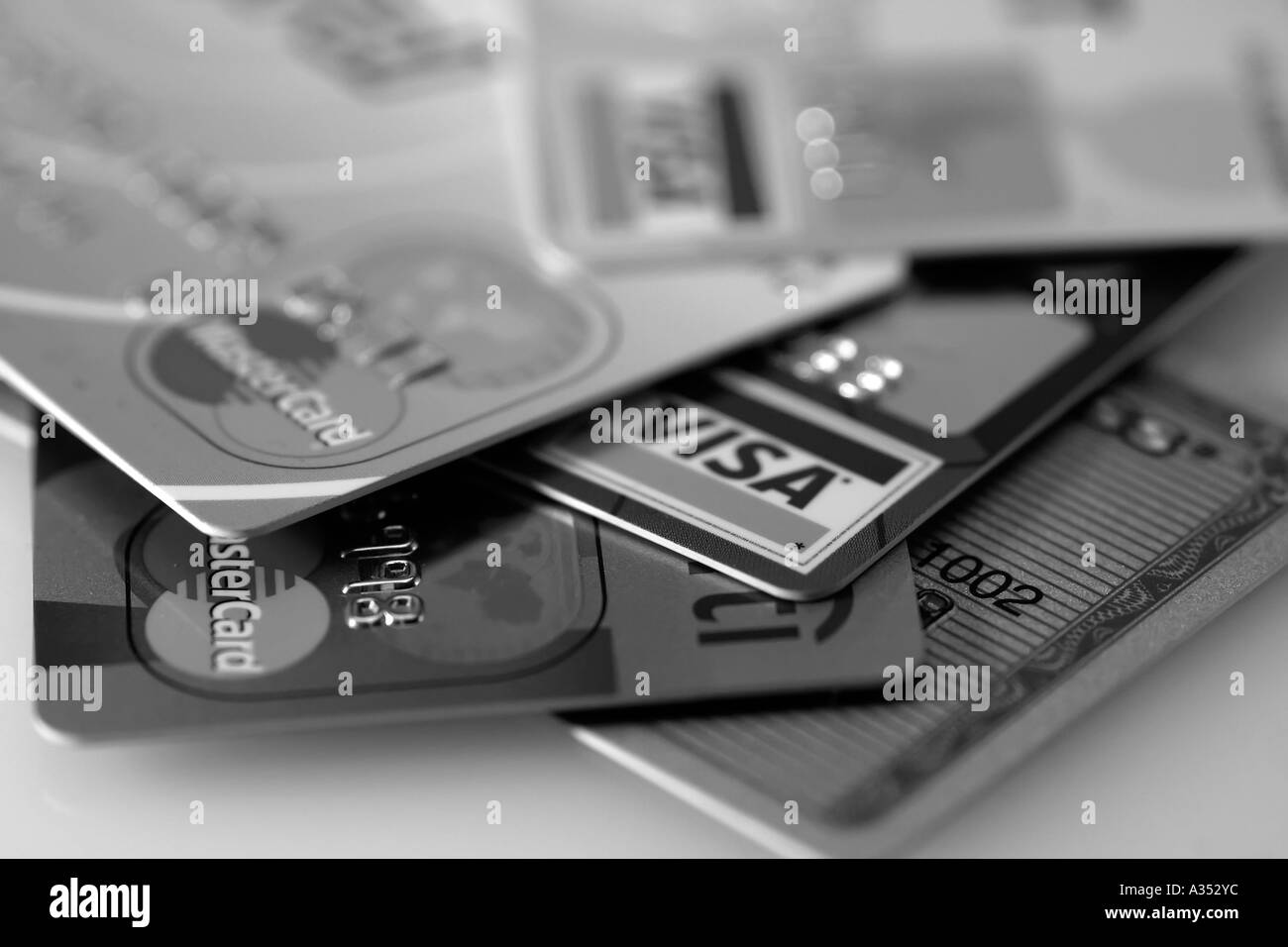 Black-and-white close-up of major credit cards - Stock Image