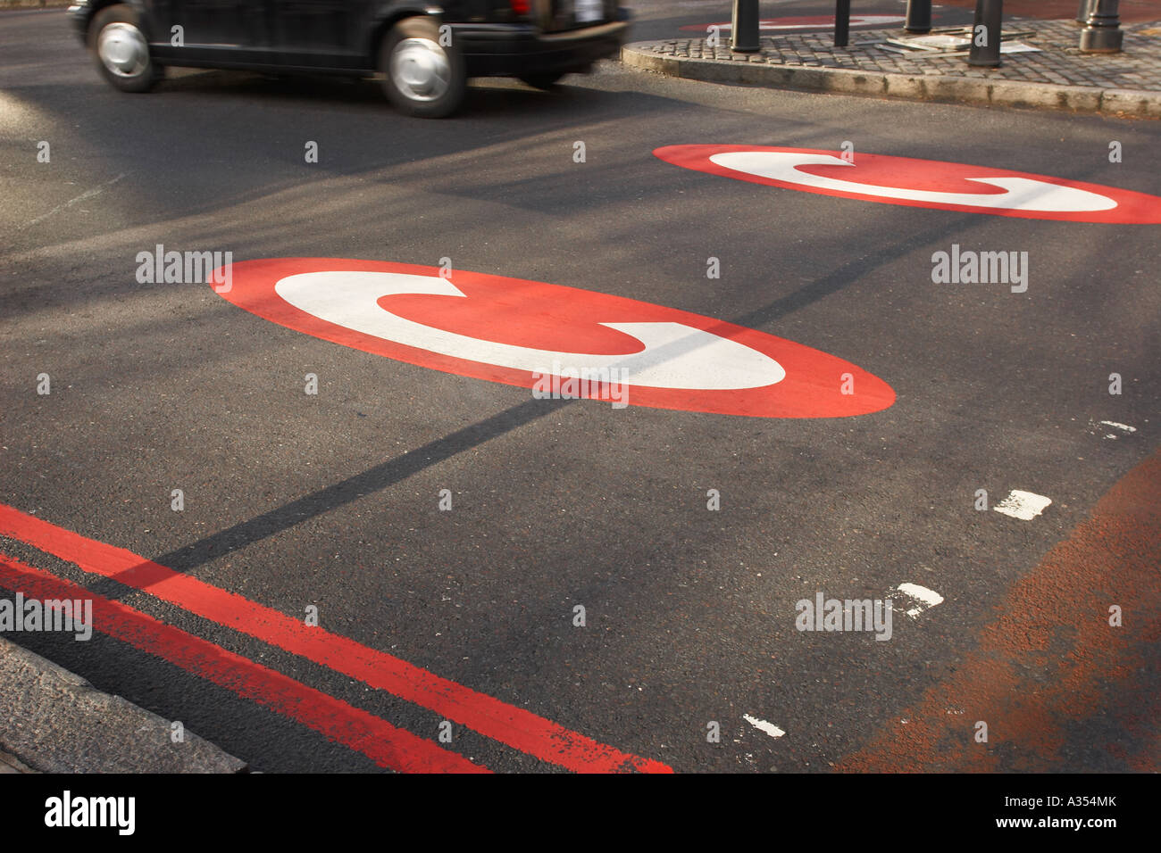 Congestion Charge sign on the road with a taxi  cab london - Stock Image