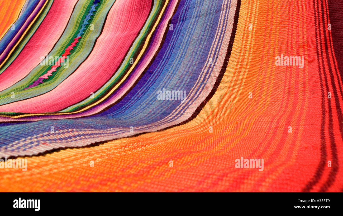 Detail of brightly coloured woven shawls zut from Chichicastenango Guatemala - Stock Image