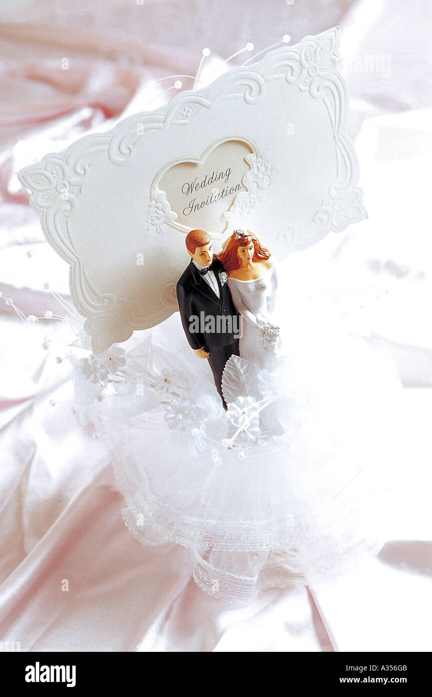Small Figures Of A Bride And Groom In Front Of The Invitation Letter Stock Photo Alamy