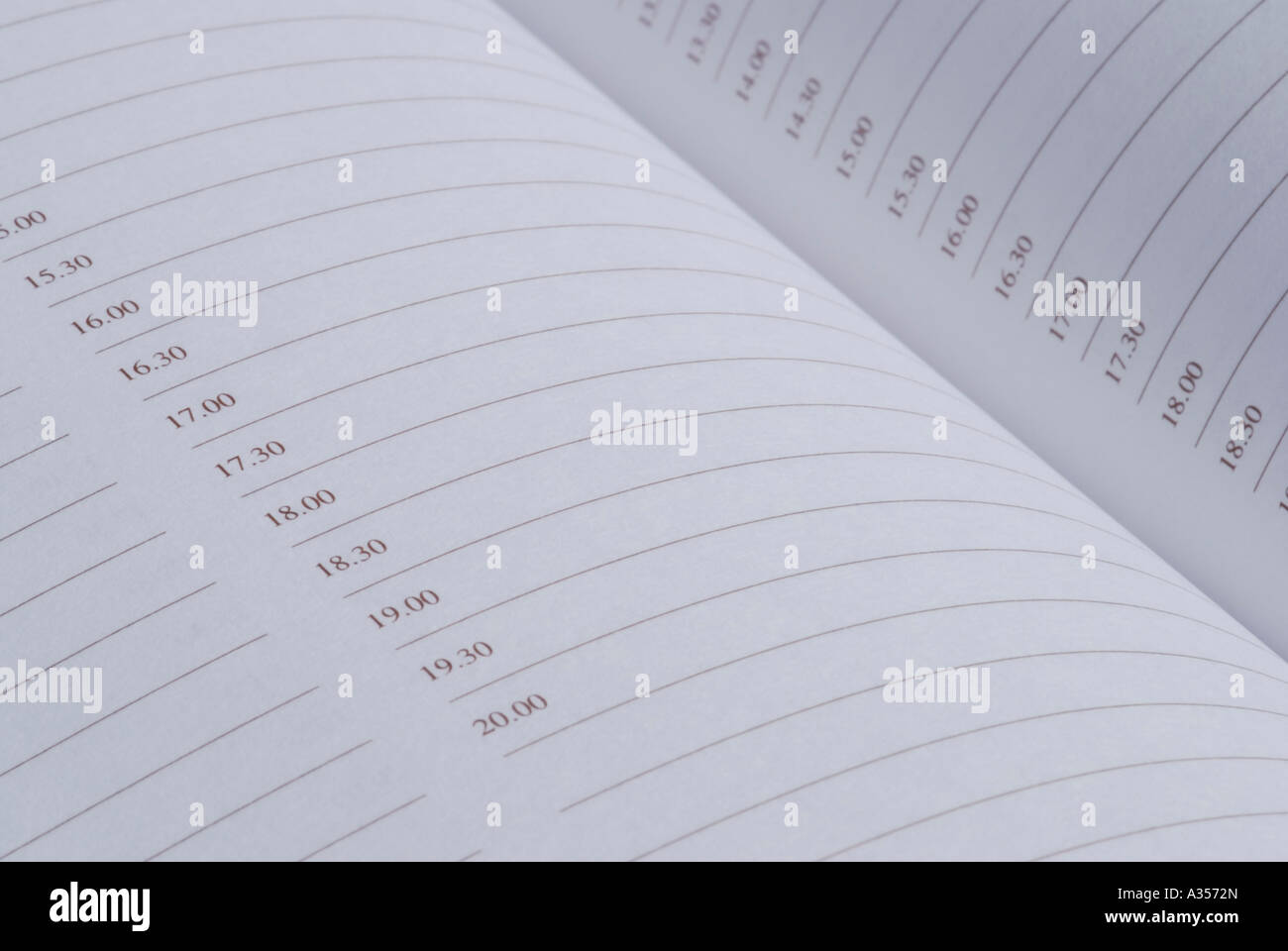Close up of diary pages showing times - Stock Image
