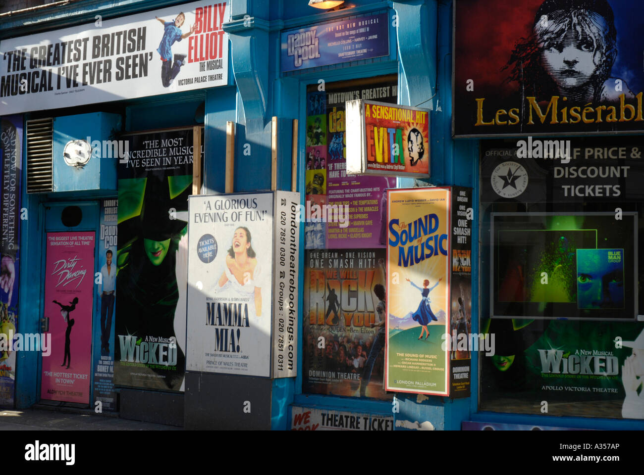 Colourful posters advertising shows outside West End theatre ticket agency London England Stock Photo
