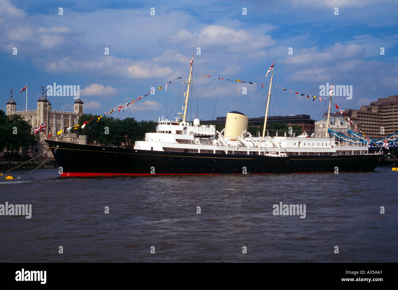 Royal Yacht Britannia moored on the River Thames with the Tower of London in the background England 1994 - Stock Image