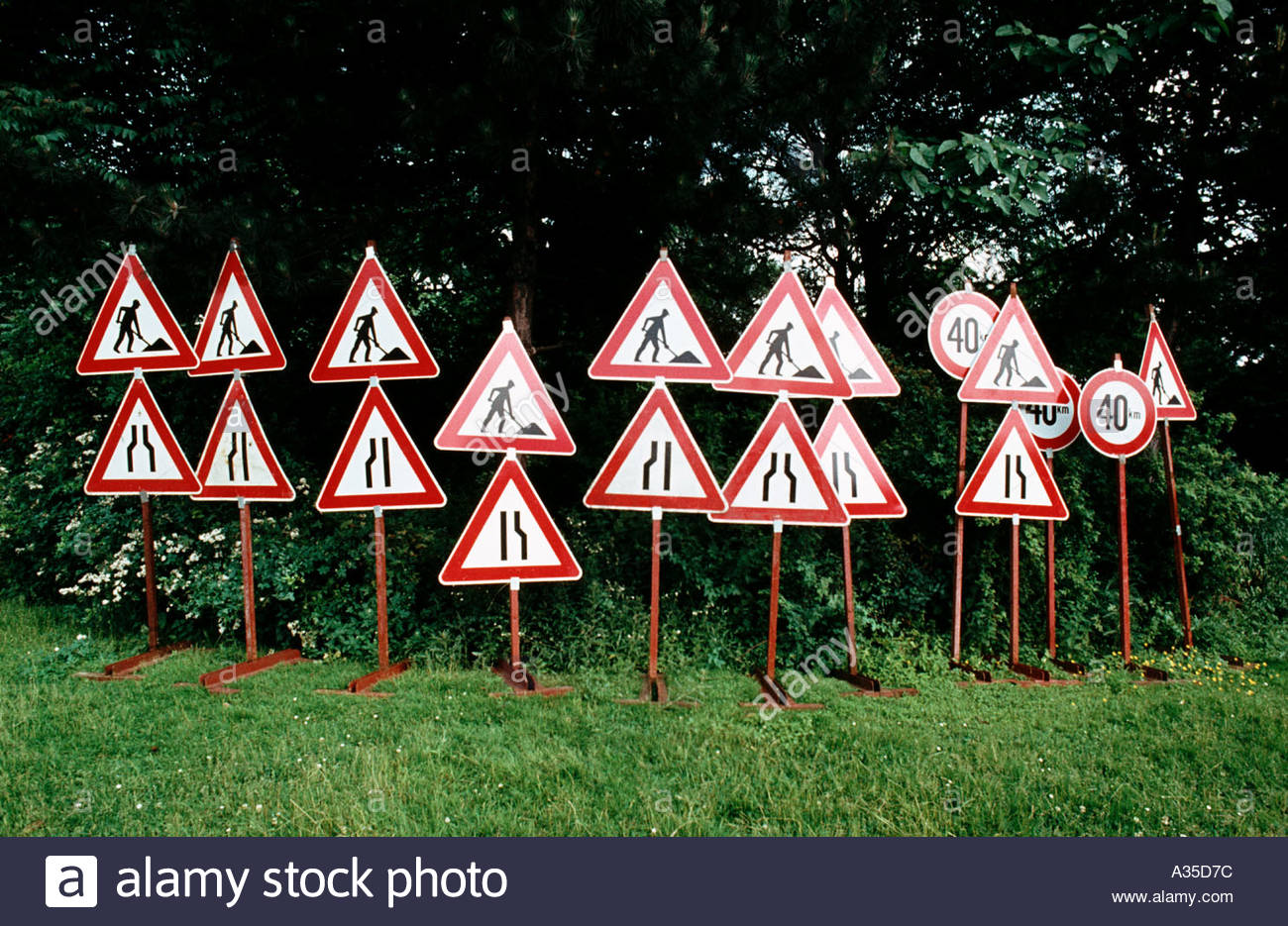 traffic signs communication road construction worker car traffic jam regulation caution slow down delay economy germany europe