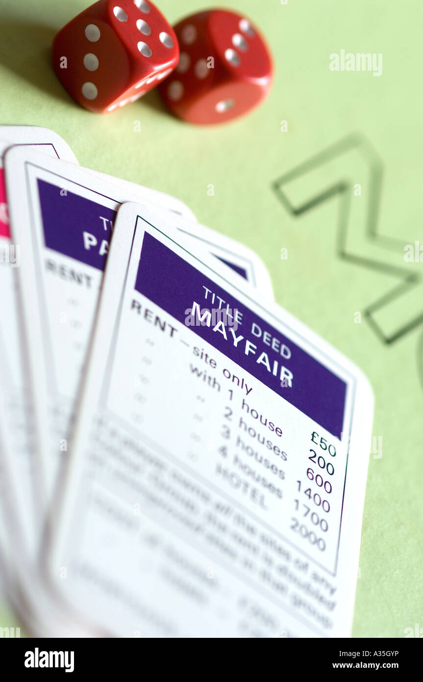 Close up of dice and monopoly cards Stock Photo