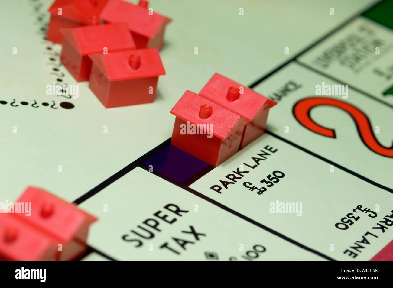 Close up of monopoly board game property and money concept Stock Photo