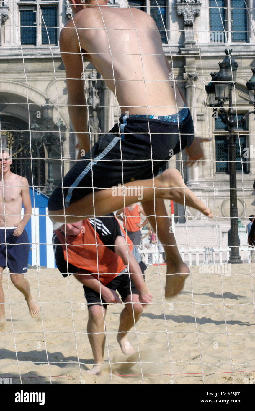 PARIS France, French Teens Playing Beach Volleyball on 'Paris Plages' Public  Festival River Seine plage - Stock Image