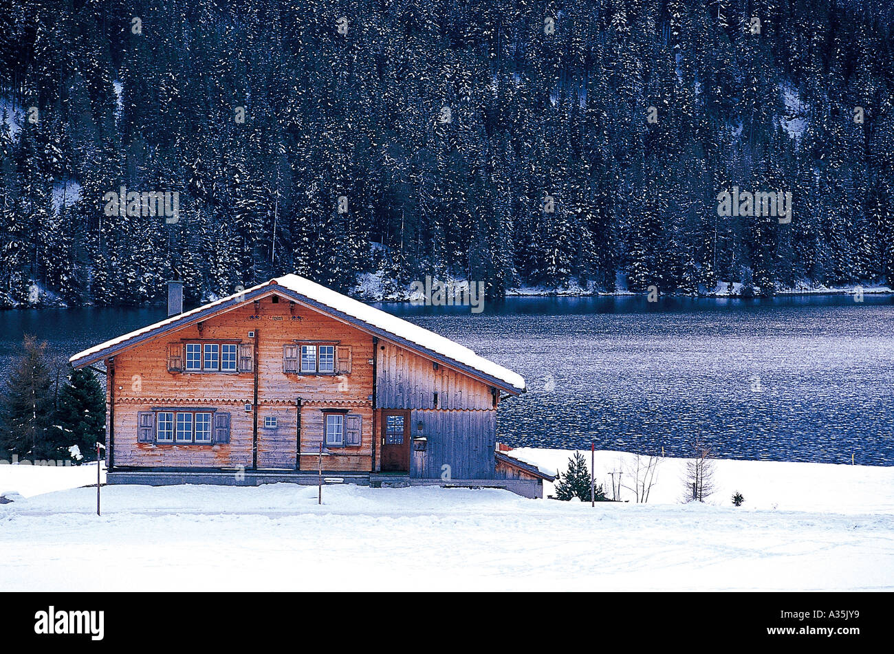 snow over wooden house in the mountains Stock Photo