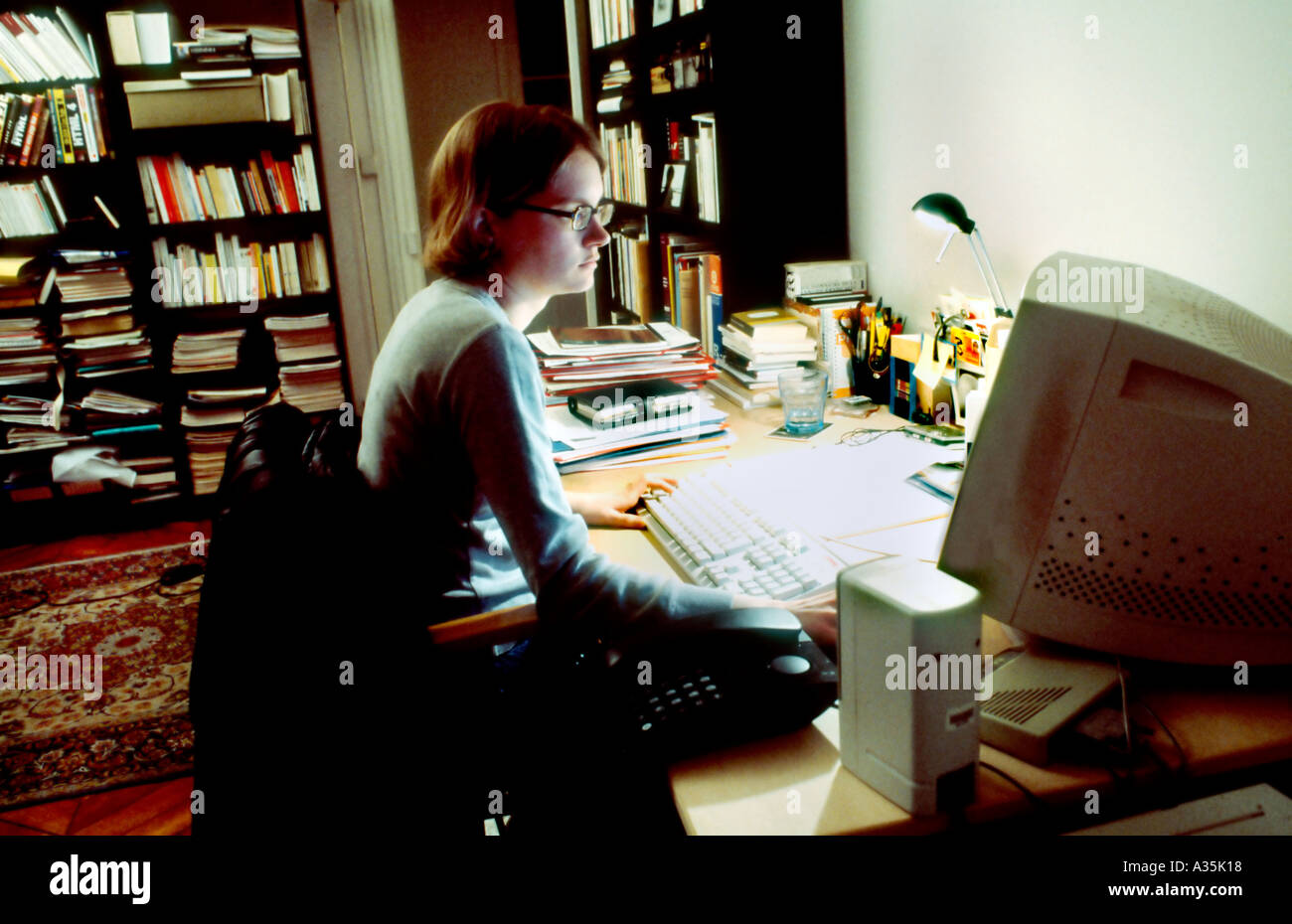 Paris, France, Young Adult Woman, Working Late on Computer in Home ...