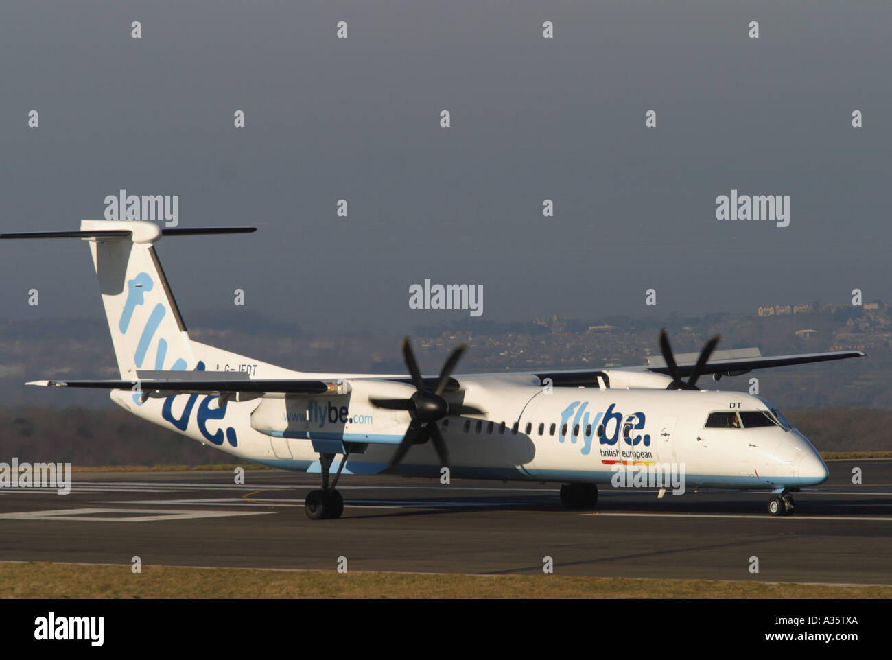 Flybe Bombardier DHC Dash 8 turboprop airliner preparing for take off at Bristol airport taken 2006 - Stock Image
