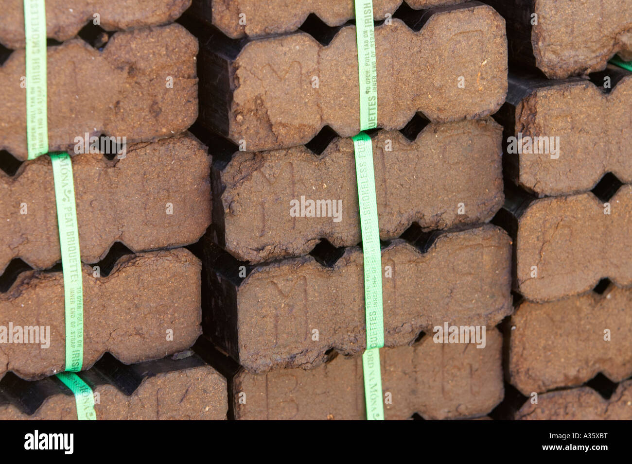 peat turf briquettes in a pile for sale in dublin - Stock Image