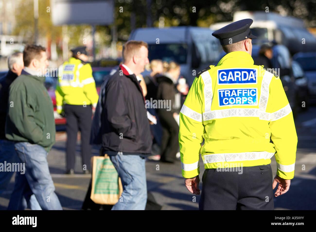 male garda siochana irish police force traffic police cop on traffic control duty on liffey bridge dublin Stock Photo