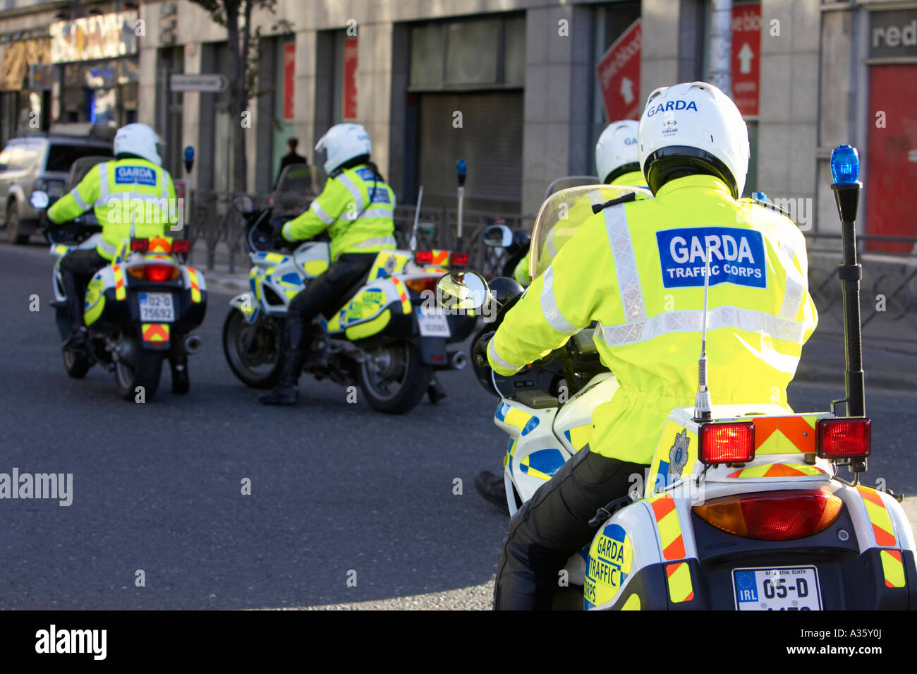 garda siochana irish police force traffic police cops on motorbikes on patrol in dublin city centre Stock Photo