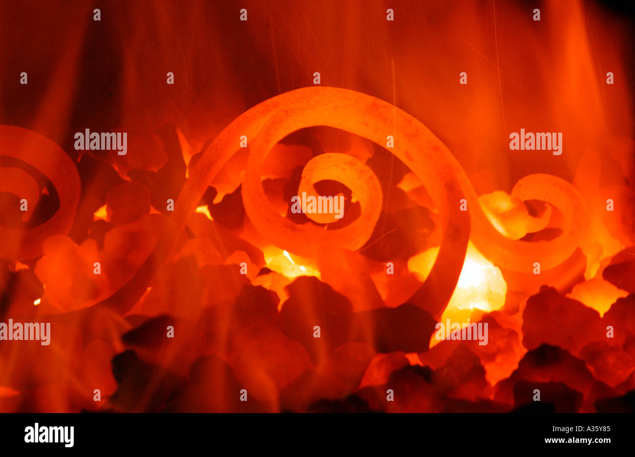 Close up of iron in a furnace - Stock Image