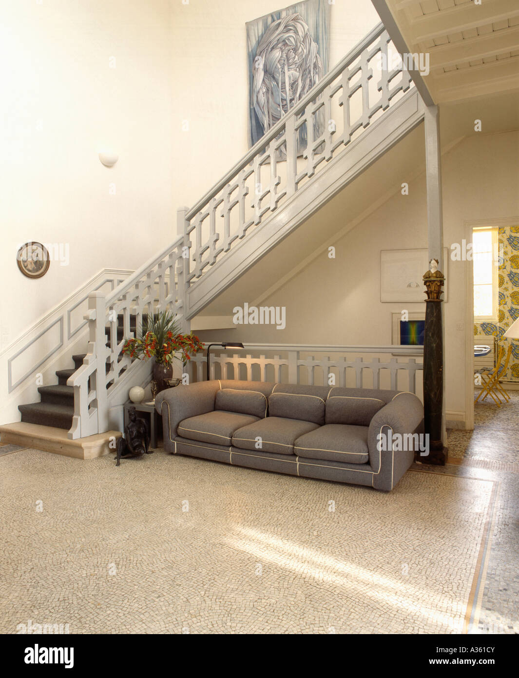 Traditional Hall With Grey Settee On Terrazzo Floor And Grey