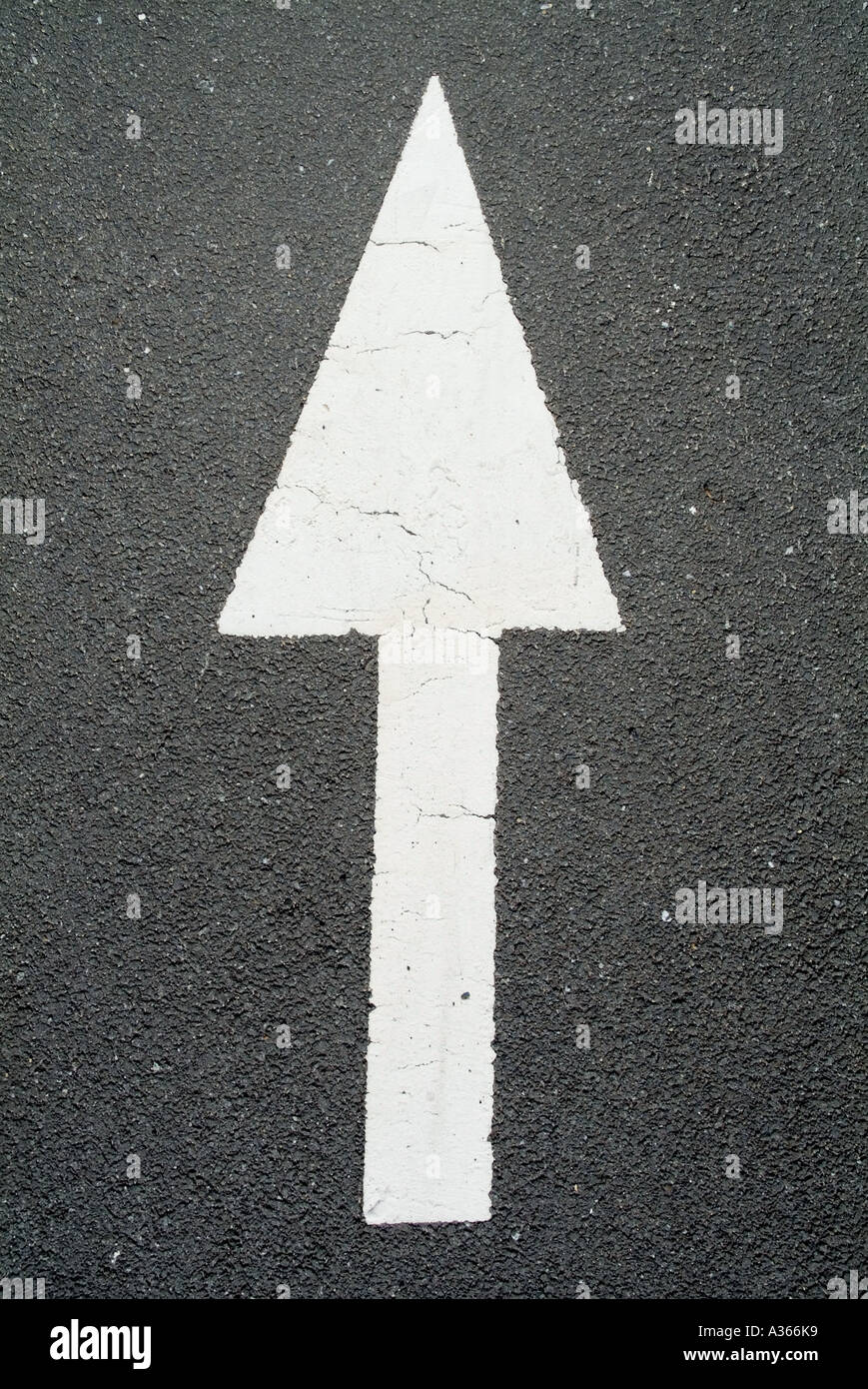 Arrow sign on the road. - Stock Image