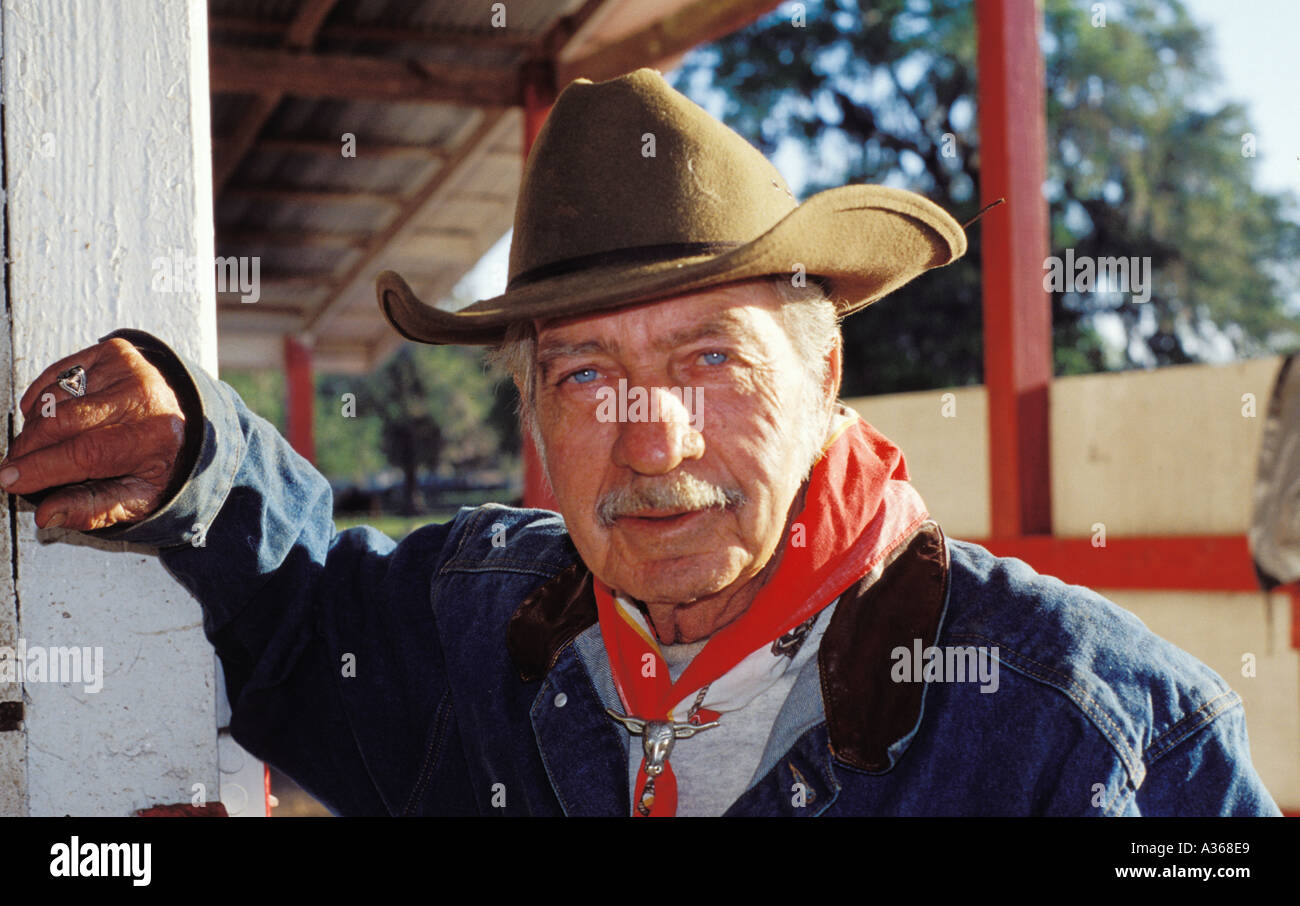 A blue eyed cowboy wears a Stetson style hat on a ranch in Ocala Florida c6bb14e3fa8