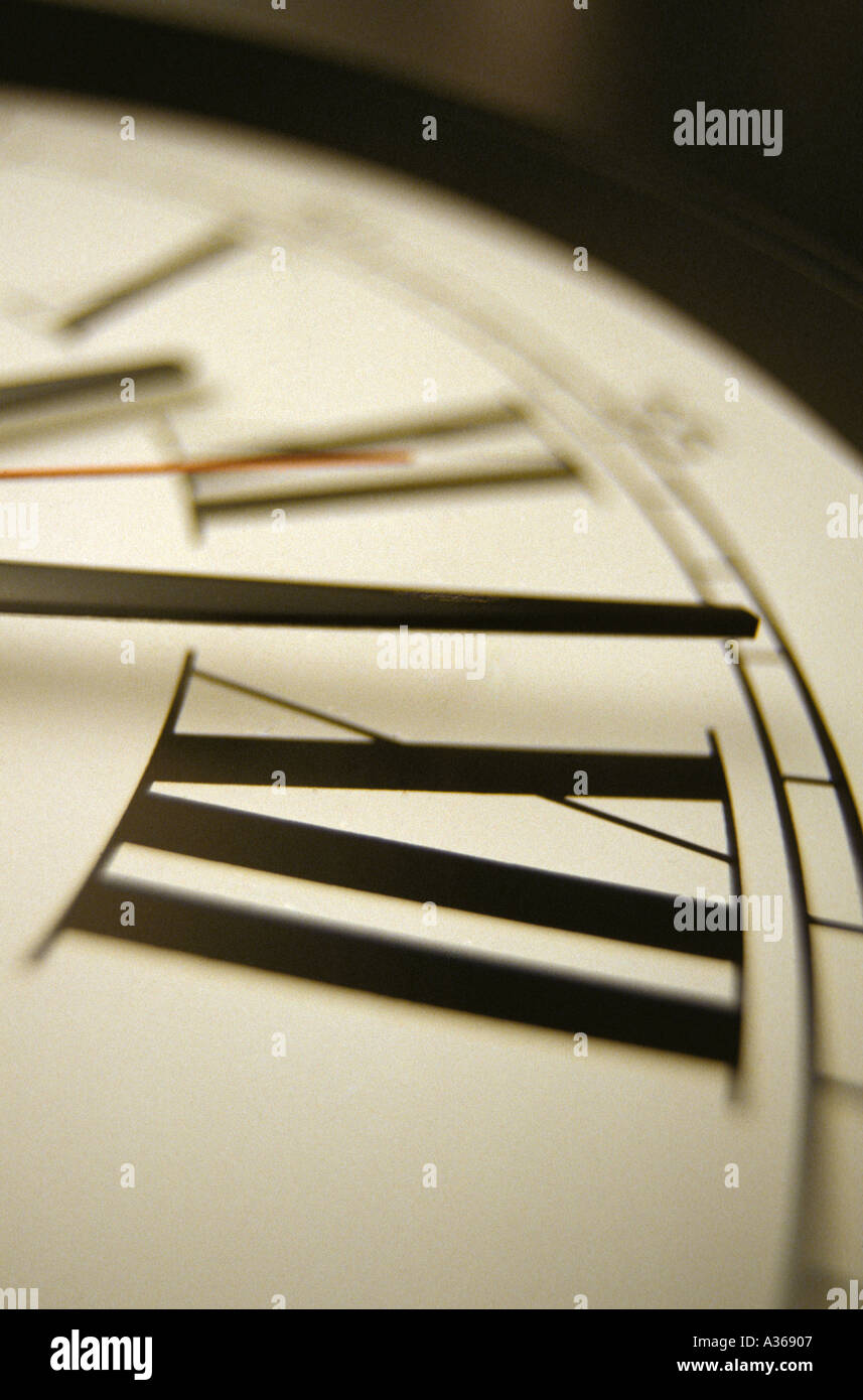 close up of clock face with roman numerals - Stock Image