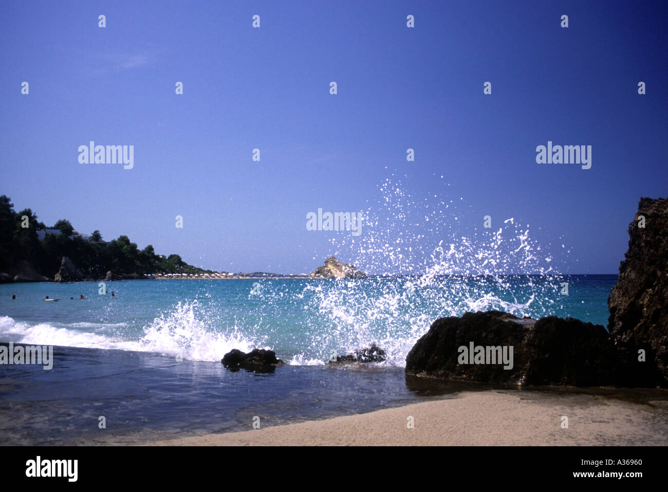Waves on a Greek Beach - Stock Image